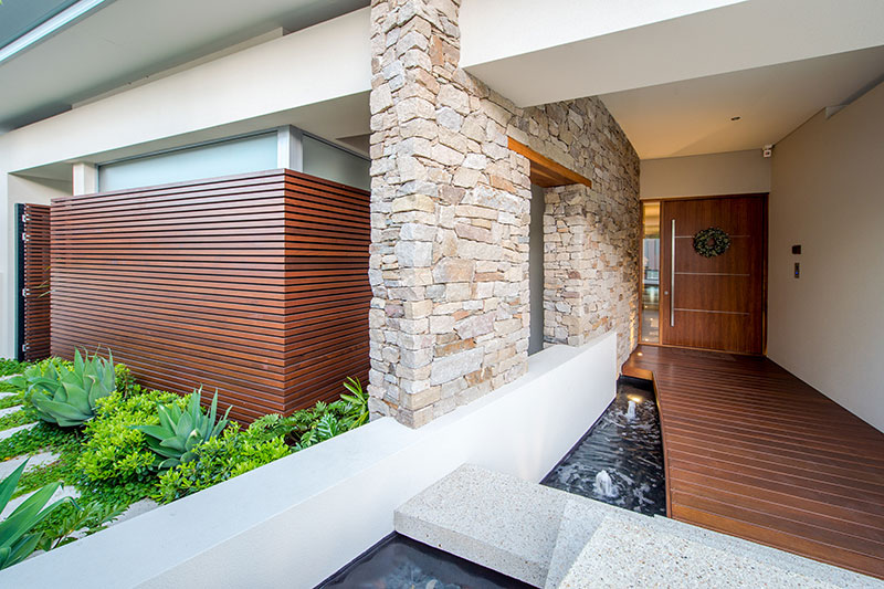 house with stone wall